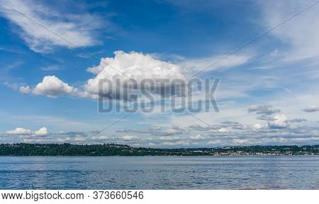Clouds That Look Like Cotton Candy Hang Over The Puget Sound In Washington State.
