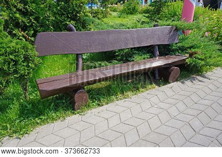 Brown Wooden Bench In Garden. Brench In The Park.