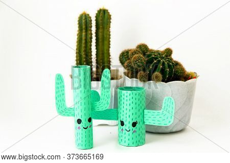 Step-by-step Lesson: How To Make A Cute Cactus From A Toilet Sleeve And Colored Paper. Using Scissor
