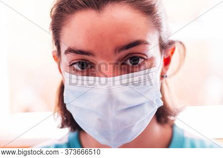 Teenager With A Mask Staring At A Camera. With Copyspace, In His Room. Concept Of New Normality And