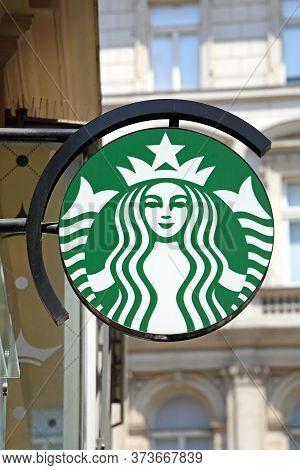 Vienna, Austria - July 12, 2015: Famous Starbucks Woman Sign At Building In Vienna, Austria.