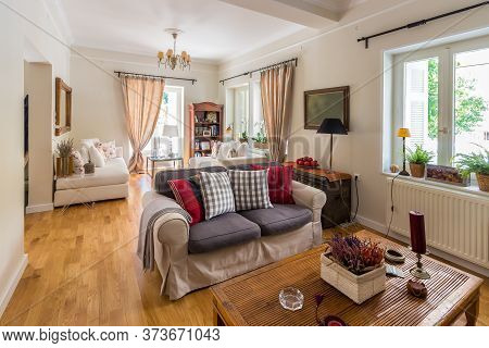 Large Living Room Very Bight With Oak Wooden Floor And Retro Objets In Greece.