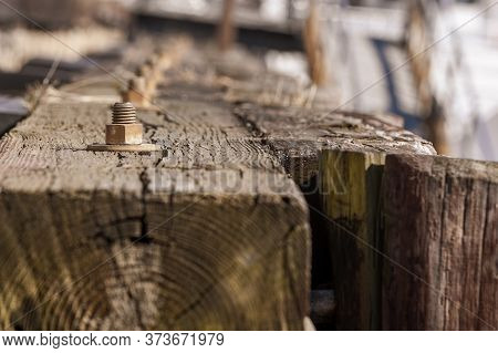 Thick Wooden Beams And Pilings Edging New Bedford Wharf