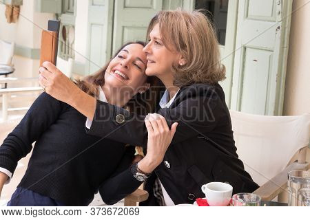 A Senior Woman, 61, Taking A Selfie With Her Mobile Together With Her 46 Years Old Friend, Lifestyle