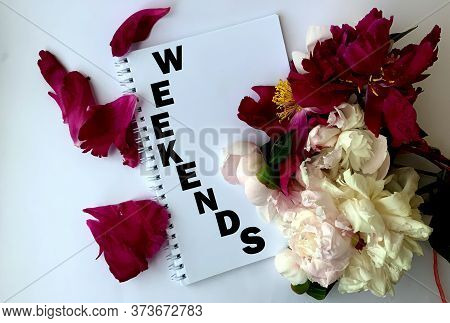 Weekends On A White Notepad, Peonies On A White Background.the Concept Of The Weekend.