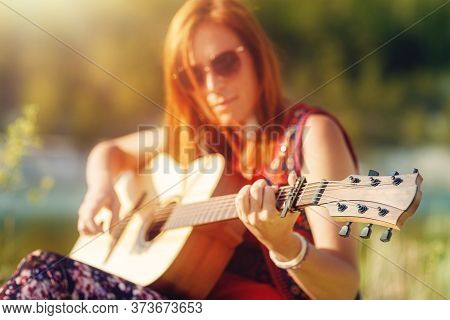 Beautiful Woman Playing With Guitar In Nature.