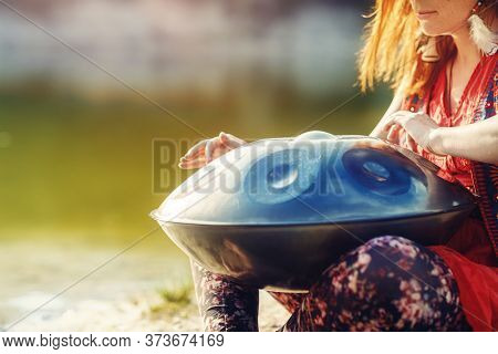 Beautiful Woman Playing With Hangdrum In Nature.