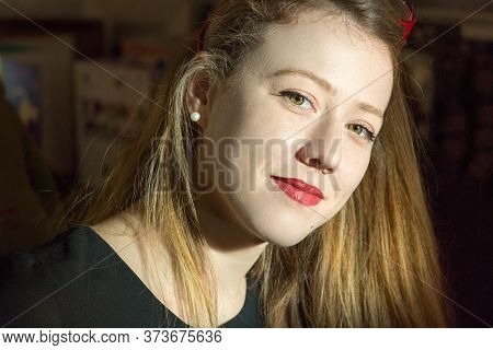 Portrait Of A Blonde Young Woman Looking Camera In A Confident Way, Closeup Headshot, Natural Light,