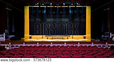 Concert Or Performance Hall. Red Seats Armchairs And The Stage Before Concert.