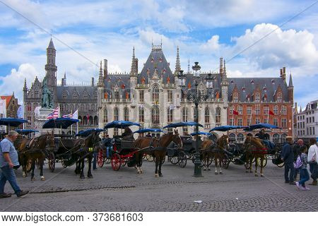 Horse Carriages On Market Square (grote Markt), Bruges, Belgium - June 2018