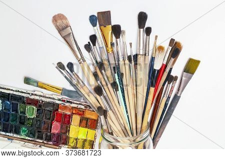 Set Of Artist Accessories Collection.art Brushes Of Various Sizes, Watercolors On A White Background