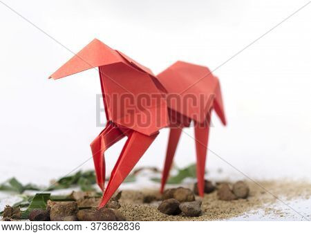 Origami Concept. Origami Paper Horse. With Front View In Focus And Back Out-of-focus.