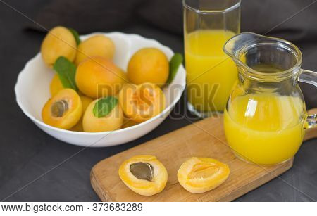 Apricots In A White Plate And Apricot Juice. Apricots On A Wooden Board. Dark Background. Copyspace