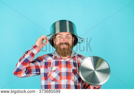 Cooking Utensils. Cooking Vessels. Kitchen Advertising. Crazy Chef. Man With Saucepan On Head. Man C