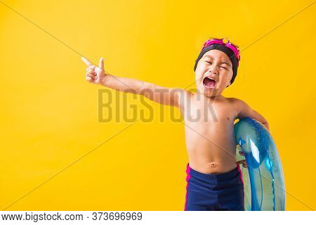 Summer Vacation Concept, Portrait Asian Happy Cute Little Child Boy Wear Goggles And Swimsuit Hold B