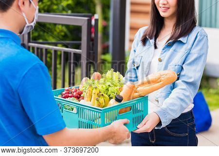 Asian Young Delivery Man Wear Face Mask Making Grocery Fast Service Giving Fresh Food Vegetable In P