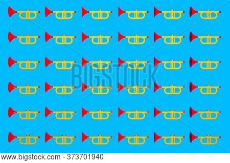 3d Illustration Of A Musical Instrument Trumpet In Yellow-red Color In Cartoon Style On A Blue Isola