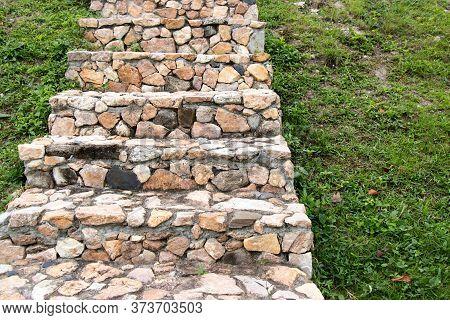 Stone Staircase Upward On Green Grass Background