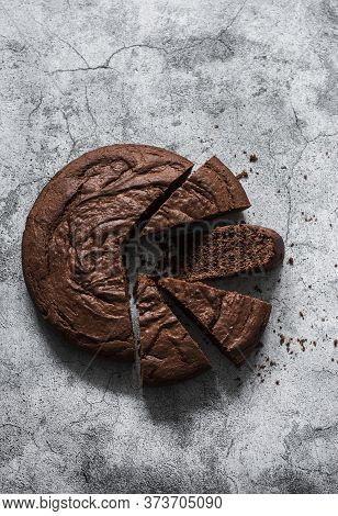Simple Chocolate Brownie Cake On A Grey Background, Top View