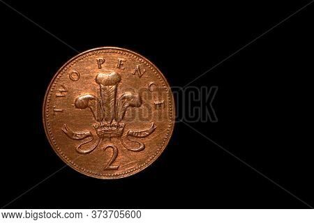 British Coin 2 Pence (2001) Isolated On Black Background With Space For Copy Text. Front Side Of Two
