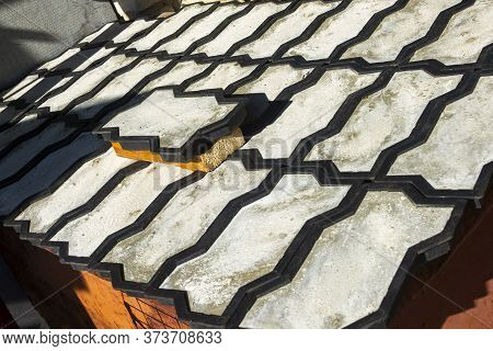 Production Of Paving Slabs From Concrete. Forms For Paving Slabs Stand In A Row.