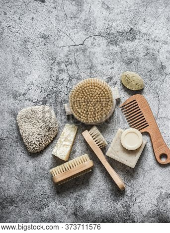 Body Care Health Concept. Natural Brushes, Soap, Pumice Stone On A Gray Background, Top View. Copy S