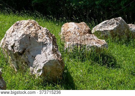 Large Jurassic Limestone Boulders In A Meadow In Sunlight In Swabian Alb, Germany