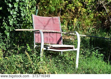 Old Chair On A Background Of Nature. Fall Season