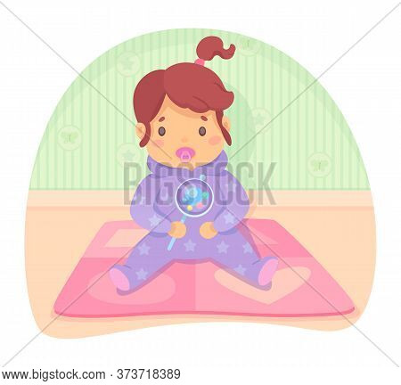 Cute Calm Baby Caucasian Girl In Jumpsuit With Dummy In Mouth Holding Beanbag Or Rattles In Hand Sit