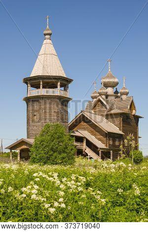 View Of The Wooden Church Of Dmitry Solunsky On A Sunny June Day. Village Shcheleiki, Leningrad Obla