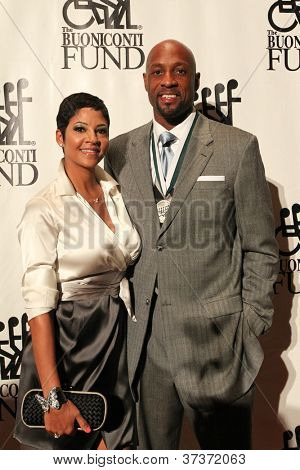 NEW YORK-SEPT. 24: Former basketball player Alonzo Mourning (R) and wife Tracy attend the 27th Great Sports Legends Dinner at the Waldorf-Astoria on September 24, 2012 in New York City.