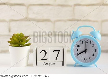 August 27 On A Wooden Calendar Next To The Alarm Clock. Summer Day, Empty Space For Text.calendar Fo