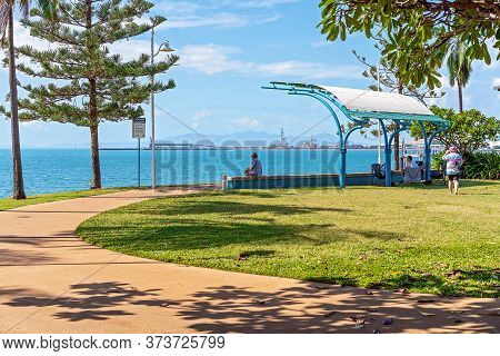 Townsville, Queensland, Australia - June 2020: People Relaxing On The Foreshore Of The Strand Enjoyi