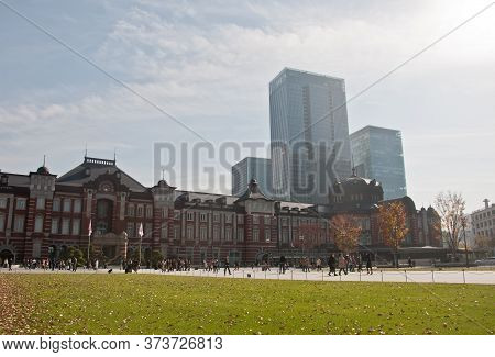 Tokyo, Japan - December 1, 2018:  Tokyo Station Railway Building With Gingko Yellow Foliage Leaves T