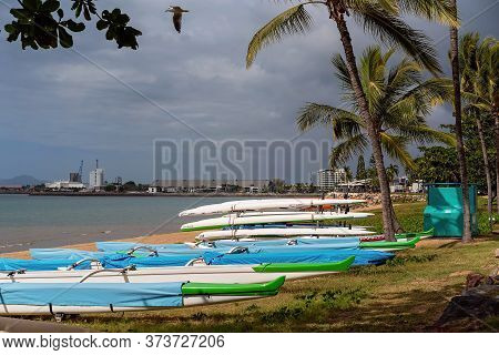 Townsville, Queensland, Australia - June 2020: Row Boats Stacked On The Beach Foreshore With An Indu
