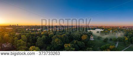 Fog In Munich. Misty Aerial View In The Popular Englischer Garten And A Total View Ovewr The Skyline