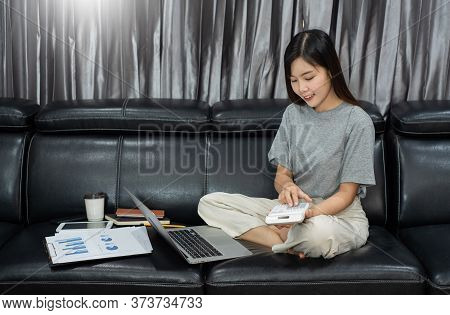 Attractive Young Beautiful Asian Woman Entrepreneur Or Freelancer Working At Home With Laptop Busine