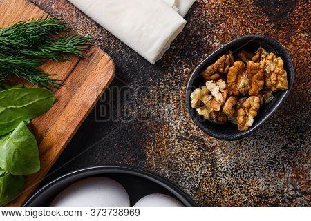 Walnuts Nuts In Black Bowl Top View.