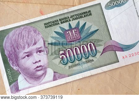 Obverse Of 50.000 Dinars Paper Banknote Issued By Yugoslavia That Shows Portrait Of Young Boy