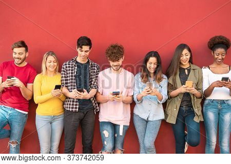 Group Young Friends Using Mobile Smartphone Outdoor - Millennial Generation Having Fun With New Tren