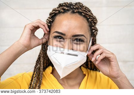 Young Afro Woman With Braids Wearing Face Medical Mask Portrait - African Girl Using Facemask For Pr