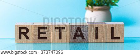 Retail - Words From Wooden Blocks With Letters, Distributive Trades Retail Concept, Blu Background