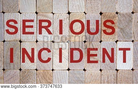 Wooden Blocks Form The Words 'serious Incident'. Beautiful Wooden Background.