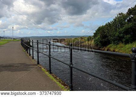 River Estuary Walkway At Largs Scotland On An Overcast Afternoon
