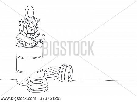 Single Continuous Line Drawing Of Young Beautiful Muslimah Siting On Oil Drum And Hold Dslr Camera.