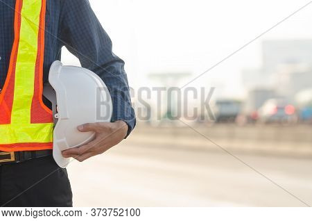 White Helmet Is In The Hands Of Road Construction Engineers.