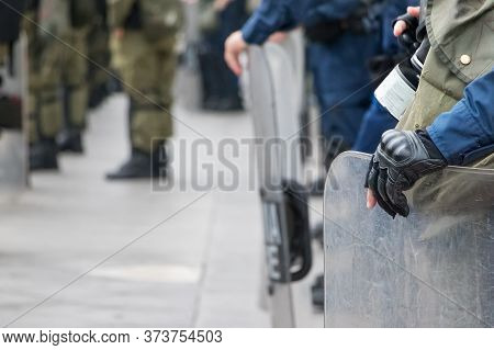 Male Riot Police Holding His Shield With His Hand, Outdoors.