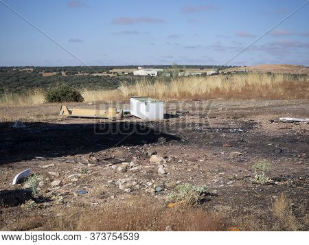 An Empty Are Of Land That Is Used As A Waste Dump