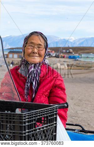 Pond Inlet, Baffin Island, Canada - August 23, 2019: Portrait Of A Eskimo - Inuit Senior Woman Outdo