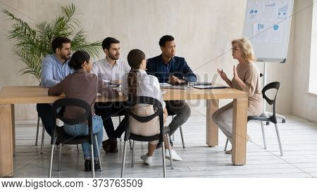 Middle Aged Businesswoman Team Leader Holding Corporate Meeting In Boardroom